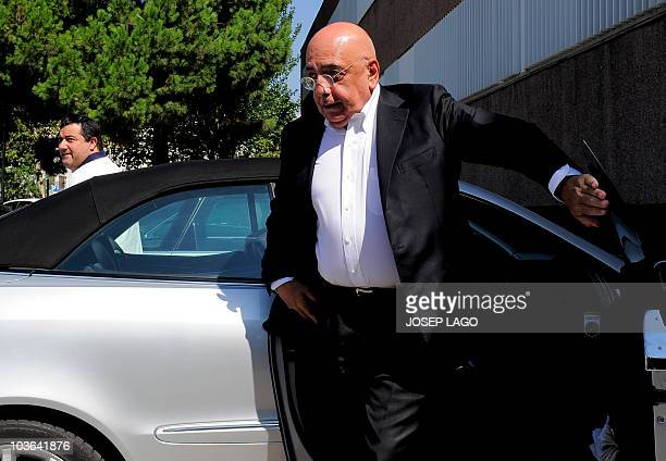 AC Milan sports director Adriano Galliani and representative for Barcelona's Swedish forward Zlatan Ibrahimovic Mino Raiola arrive at the offices of...