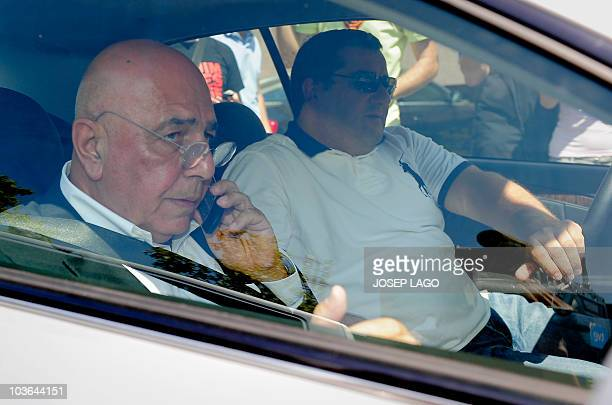 AC Milan sports director Adriano Galliani and Representative for Barcelona's Swedish forward Zlatan Ibrahimovic Mino Raiola leaving the offices of...