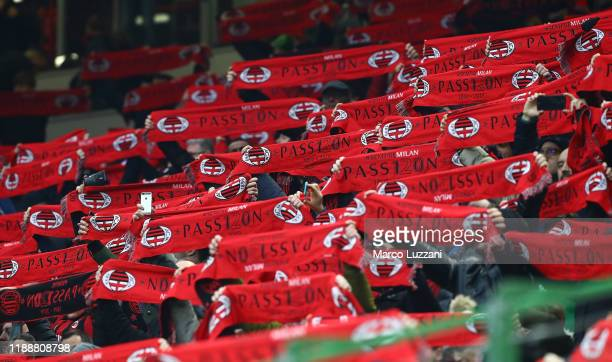 Milan supporter cheers prior to the Serie A match between AC Milan and US Sassuolo at Stadio Giuseppe Meazza on December 15 2019 in Milan Italy