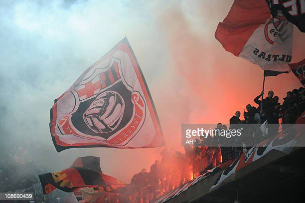 AC Milan supporter wave their flags during their team's Italian Serie A football match against Inter Milan on November 14 2010 in San Siro stadium in...