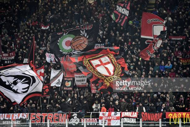 AC Milan supporters cheer prior to the Italian Serie A football match AC Milan vs Lazio at the San Siro stadium in Milan on January 31 2018