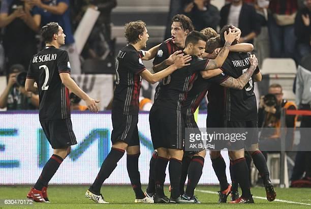 Milan team clebrates scoring a goal against Juventus FC during the Supercoppa TIM Doha 2016 match between Juventus FC and AC Milan at the Jassim Bin...