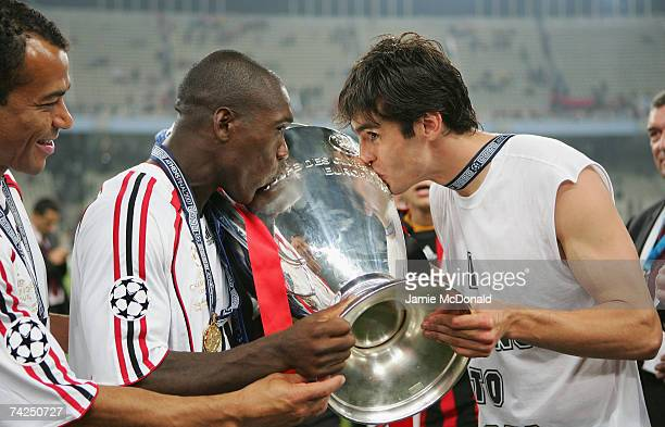 Milan teammates Clarence Seedorf and Kaka kiss the trophy following their teams 21 victory during the UEFA Champions League Final match between...