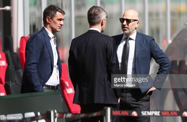 Milan Technical Area Director Paolo Maldini speaks to AC Milan Chief Executive Officer Ivan Gazidis before the Serie A match between AC Milan and UC...