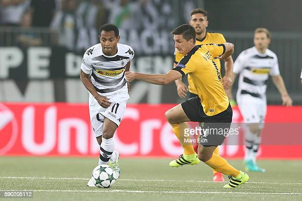 Milan Vilotic of Young Boys Bern challenges Raffael Caetano de Araujo of Borussia Moenchengladbach during the Champions League Playoff match between...