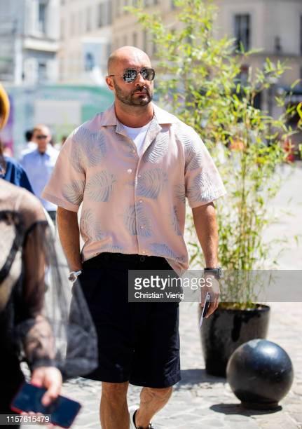 Milan Vukmirovic is seen wearing button shirt outside Thom Browne during Paris Fashion Week - Menswear Spring/Summer 2020 on June 22, 2019 in Paris,...
