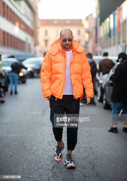 Milan Vukmirovic is seen wearing orange down feather jacket outside Marni during Milan Menswear Fashion Week Autumn/Winter 2019/20 on January 12 2019...