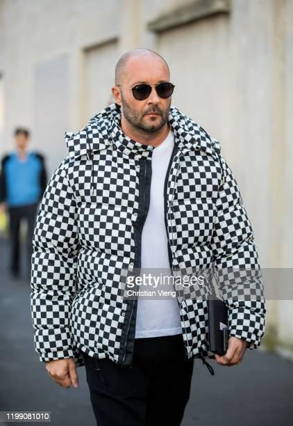 Milan Vukmirovic seen wearing black white down feather jacket outside Prada during Milan Fashion Week Fall/Winter 2020/2021 on January 12 2020 in...