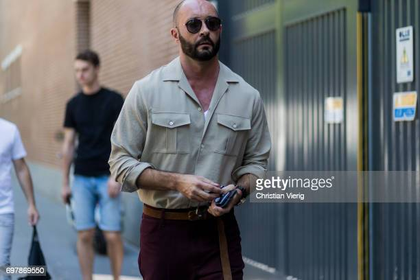 Milan Vukmirovic wearing a khaki button shirt is seen outside Fendi during Milan Men's Fashion Week Spring/Summer 2018 on June 19 2017 in Milan Italy