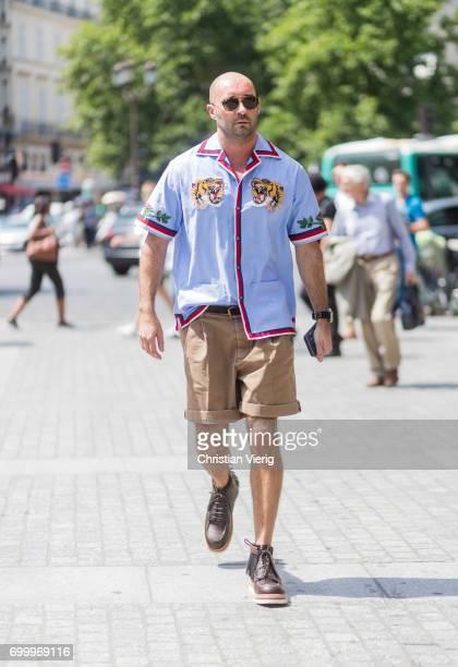 Milan Vukmirovic wearing khaki shorts blue button shirt outside Louis Vuitton during Paris Fashion Week Menswear Spring/Summer 2018 on June 22 2017...