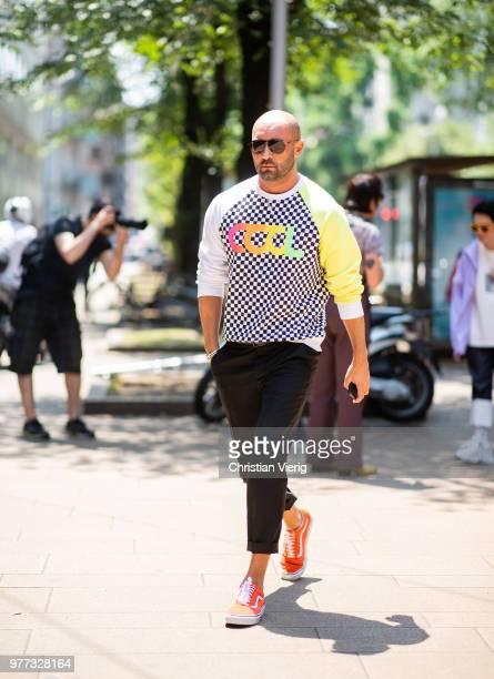 Milan Vukmirovic wearing knit with print cool is seen outside Sunnei during Milan Men's Fashion Week Spring/Summer 2019 on June 17 2018 in Milan Italy