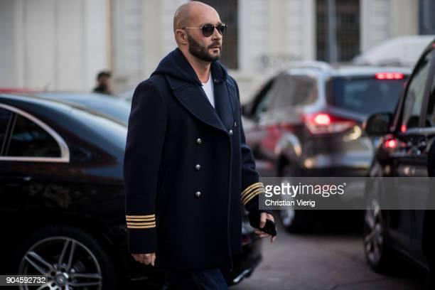Milan Vukmirovic wearing navy jacket is seen outside Marni during Milan Men's Fashion Week Fall/Winter 2018/19 on January 13 2018 in Milan Italy