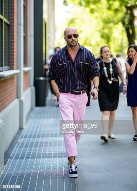 Milan Vukmirovic wearing pink pants is seen outside Fendi during Milan Men's Fashion Week Spring/Summer 2019 on June 18 2018 in Milan Italy