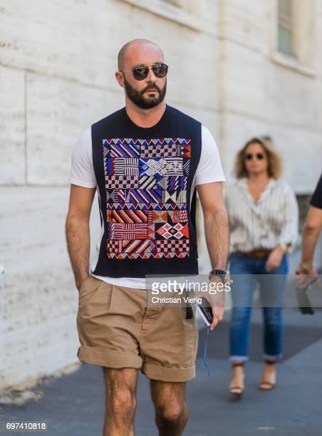Milan Vukmirovic wearing shorts is seen outside Salvatore Ferragamo during Milan Men's Fashion Week Spring/Summer 2018 on June 18 2017 in Milan Italy