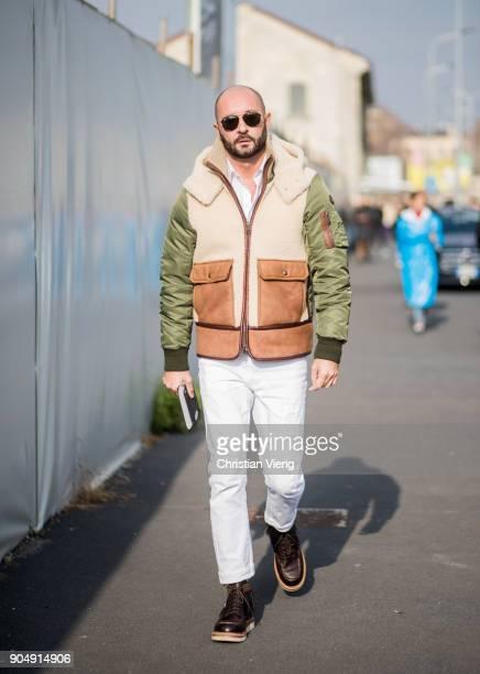Milan Vukmirovic wearing white pants bomber jacket is seen outside DSquared2 during Milan Men's Fashion Week Fall/Winter 2018/19 on January 14 2018...