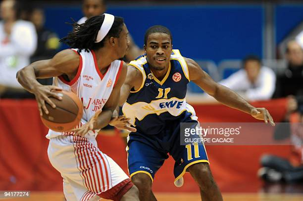 AJ Milano's US player Morris Finley fights for the ball with Oldenburg's US player Bryan Bailey during their Euroleague basketball match on December...