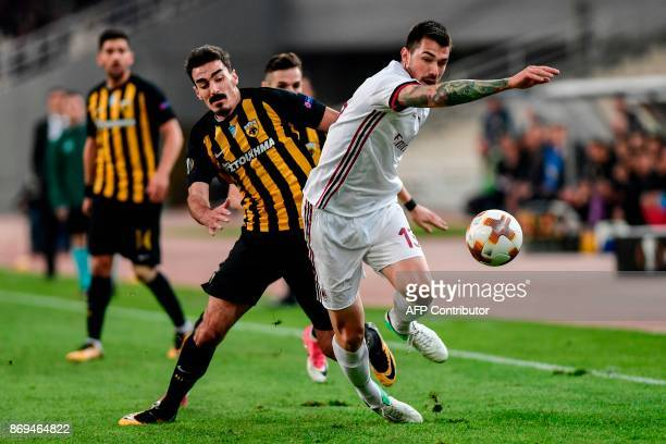AC Milan's Alessio Romagnoli vies for the ball with AEK's Lazaros Christodoulopoulos during the UEFA Europa League Group D football match between AEK...