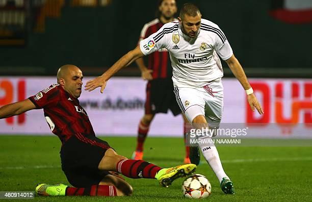 AC Milan's Alex Dias da Costa vies for the ball against Real Madrid's Karim Benzema during their world club friendly football match at the Sevens...