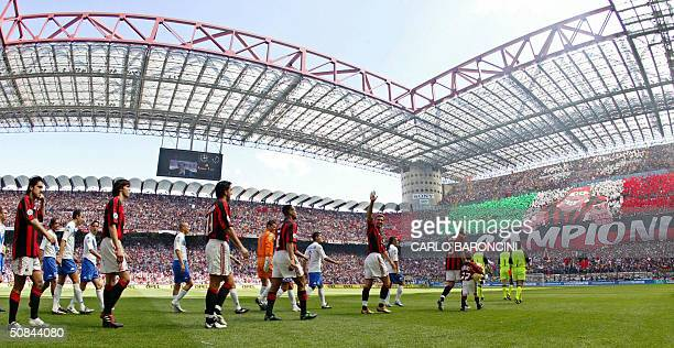 Milan's and Brescia's players walk onto the field, prior their Italian Serie A football match at San Siro stadium in Milan, 16 May 2004. For the...