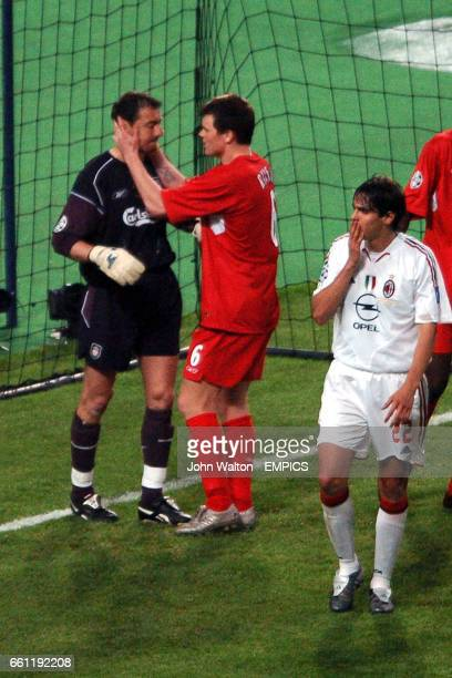 AC Milan's and Liverpool goalkeeper Jerzy Dudek is congratulated on his save to deny Andriy Shevchenko by teammate John Arne Riise as AC Milan's Kaka...