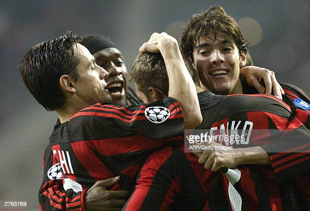 Milan's Andriy Shevchenko is congratulated by Filippo Inzaghi Clarence Seedorf and Kaka during their Group D Champions League match 26 November 2003...