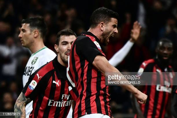 AC Milan's Argentine defender Mateo Musacchio celebrates with his teammates after scoring a goal during the Italian Serie A football match between AC...