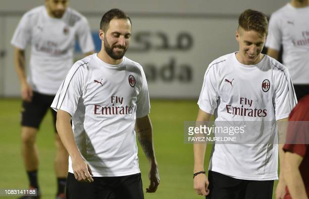 AC Milan's Argentine forward Gonzalo Higuain and AC Milan's Italian defender Andrea Conti takes part in a training session at the King Abdullah...