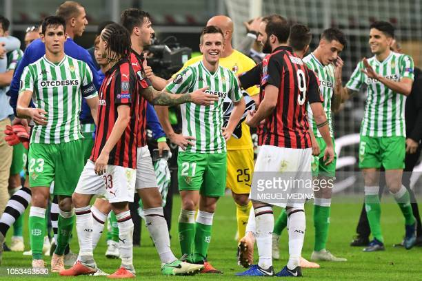 AC Milan's Argentine forward Gonzalo Higuain and Real Betis' Argentine midfielder Giovani Lo Celso react at the end of the UEFA Europa League group F...
