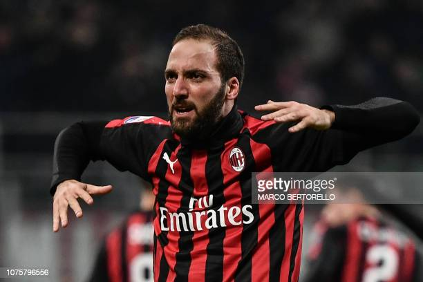 AC Milan's Argentine forward Gonzalo Higuain celebrates after scoring 21 during the Italian Serie A football match AC Milan vs Spal on December 29...