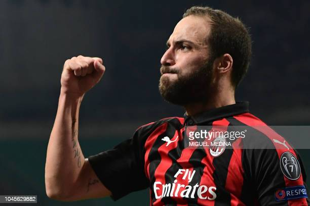 AC Milan's Argentine forward Gonzalo Higuain celebrates after scoring during the Europa League Group F football match between AC Milan and Olympiakos...