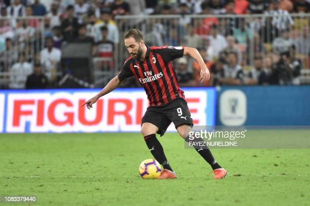 AC Milan's Argentine forward Gonzalo Higuain controls the ball during their Supercoppa Italiana final between Juventus and AC Milan at the King...