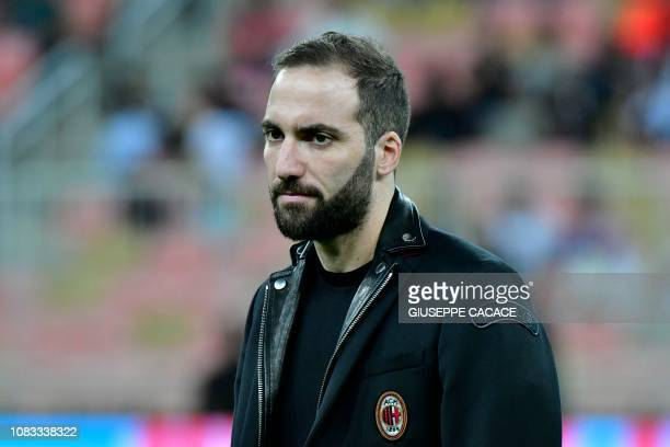 AC Milan's Argentine forward Gonzalo Higuain is seen on the pitch ahead of Supercoppa Italiana final between Juventus and AC Milan at the King...