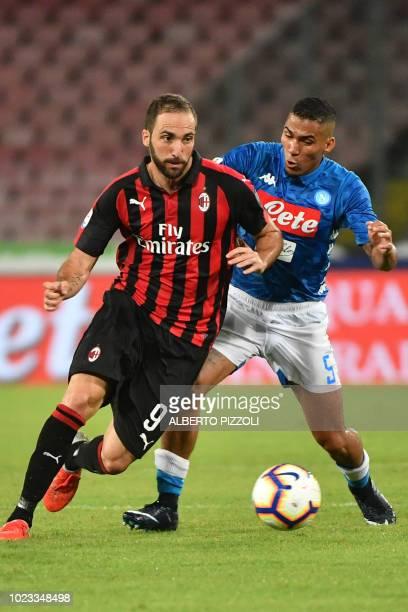 AC Milan's Argentine forward Gonzalo Higuain outruns Napoli's Brazilian midfielder Allan during the Italian Serie A football match Napoli vs AC Milan...