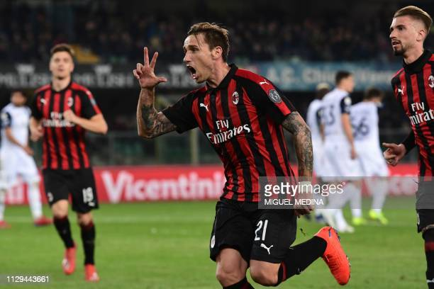 AC Milan's Argentine midfielder Lucas Biglia celebrates after scoring a free kick during the Italian Serie A football match Chievo Verona vs AC Milan...