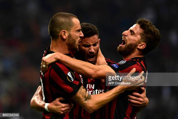 AC Milan's Argentinian defender Mateo Musacchio celebrates with teammates Leonardo Bonucci and Fabio Borini after scoring during the UEFA Europa...