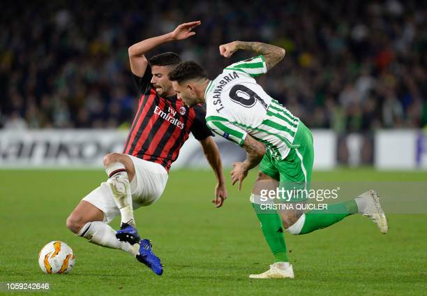 AC Milan's Argentinian defender Mateo Musacchio challenges Real Betis' Paraguayan forward Arnaldo Tonny Sanabria during the Europa League group F...