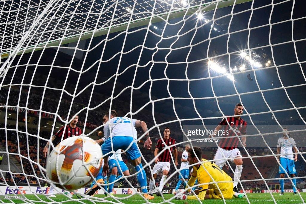 AC Milan's Argentinian defender Mateo Musacchio scores (2ndR) scores during the UEFA Europa League football match AC Milan vs HNK Rijeka at the San Siro stadium in Milan on September 28, 2017. /