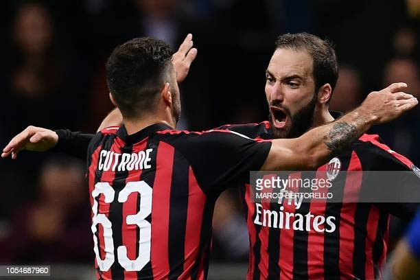 AC Milan's Argentinian forward Gonzalo Higuain celebrates after scoring during the Italian Serie A football match AC Milan vs Sampdoria at the...