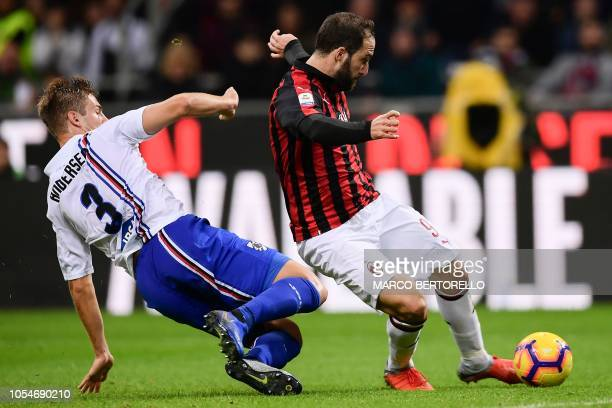 AC Milan's Argentinian forward Gonzalo Higuain shots and scores during the Italian Serie A football match AC Milan vs Sampdoria at the 'Giuseppe...