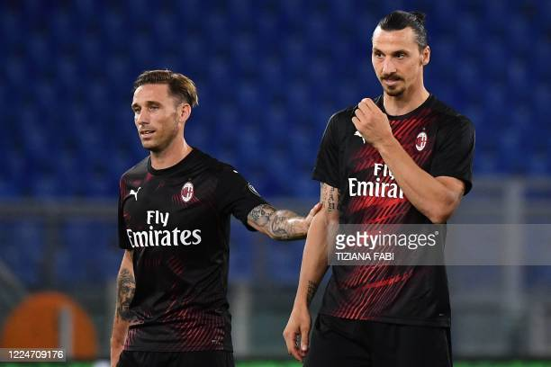 Milan's Argentinian midfielder Lucas Biglia and AC Milan's Swedish forward Zlatan Ibrahimovic react at the end of the Italian Serie A football match...