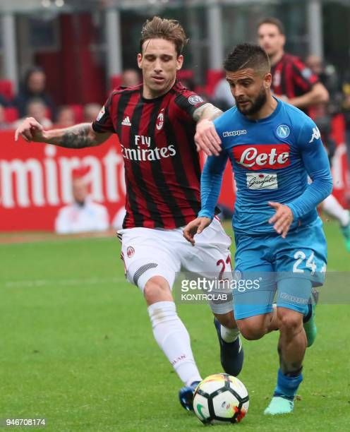 STADIUM MILAN LOMBARDIA ITALY Milan's Argentinian midfielder Lucas Biglia fights for the ball with Napoli's Italian striker Lorenzo Insigne during...