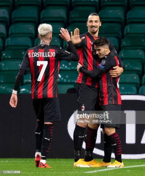 Milan's Brahim Diaz is congratulated by Zlatan Ibrahimovic and Samu Castillejo after making it 20 during the UEFA Europa League match between Celtic...