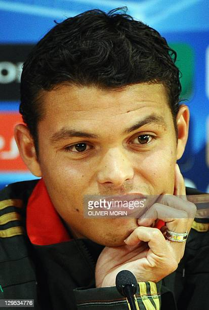 AC Milan's Brazilian defender Thiago Silva answers journalists' questions during a press conference on the eve of his team's Champions League match...