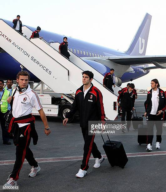 AC Milan's Brazilian forward Kaka walks with his Ukrainian teammate Andriy Shevchenko and Czech defender Marek Jankulovski upon their arrival to the...