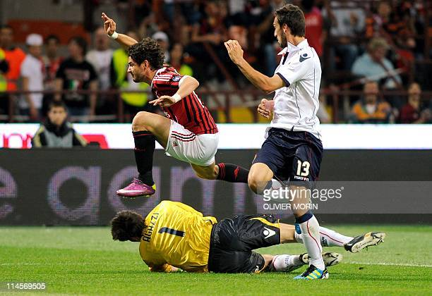 AC Milan's Brazilian forward Pato fights for the ball with Cagliari's goalkeeper Michael Agazzi and defender Davide Astori during the serie A...