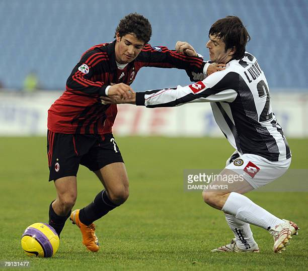 Milan's Brazilian forward Pato fights for the ball with Udinese Serbian defender Alksandar Lukovic , 20 January 2008 during the Italian Serie A...