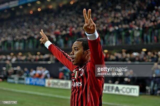 AC Milan's Brazilian forward Robinho celebrates after scoring against Arsenal during the UEFA Champions League round of 16 first leg match AC Milan...