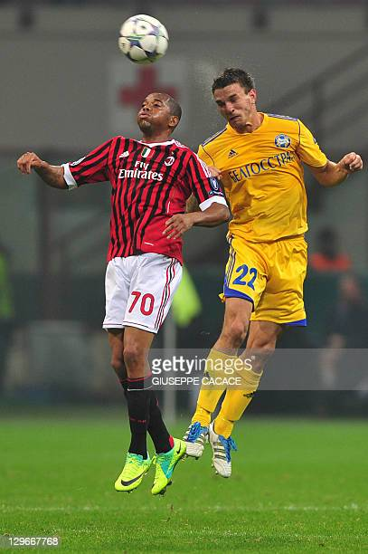 AC Milan's Brazilian forward Robinho fights for the ball with Bate Borisov's Serbian defender Marko Simic during their Champions League match on...
