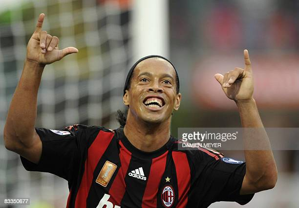 AC Milan's Brazilian forward Ronaldinho celebrates after scoring his second goal against Sampdoria during their Italian Serie A match on October 19...