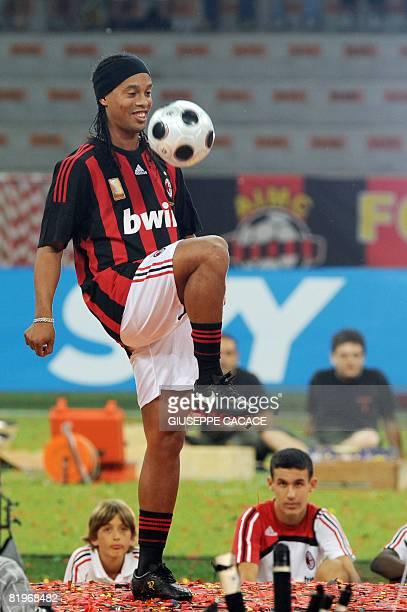 AC Milan's Brazilian forward Ronaldinho controls the ball during his presentation to supporters at San Siro Stadium on July 17 2008 Ronaldinho who...